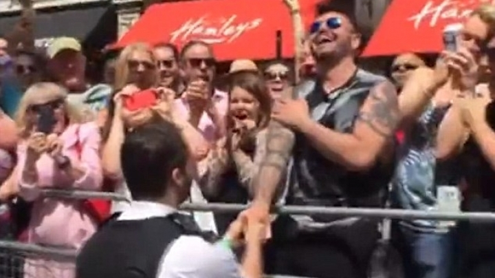 Heartwarming moment police officer breaks London Pride parade to propose to his boyfriend
