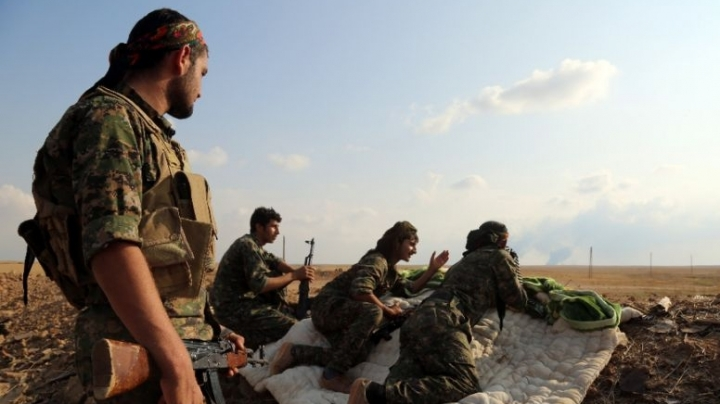 Kurdish and Arab forces enter ISIS-held city in northern Syria