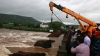 14 bodies found after a bridge collapsed in India, sending vehicles into water