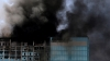 Smoke billows from skyscraper as firefighters battle huge blaze in Abu Dhabi