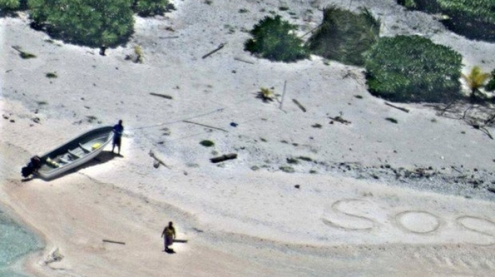 'SOS' in sand leads to rescue of 2 people stranded on Pacific island