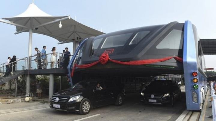 China's futuristic 'straddling bus' hits the road