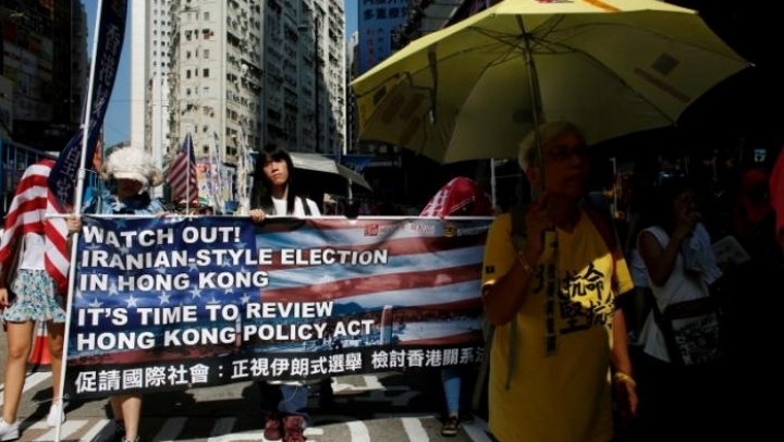 Hong Kong citizens take to streets, protesting against China's interference into elections