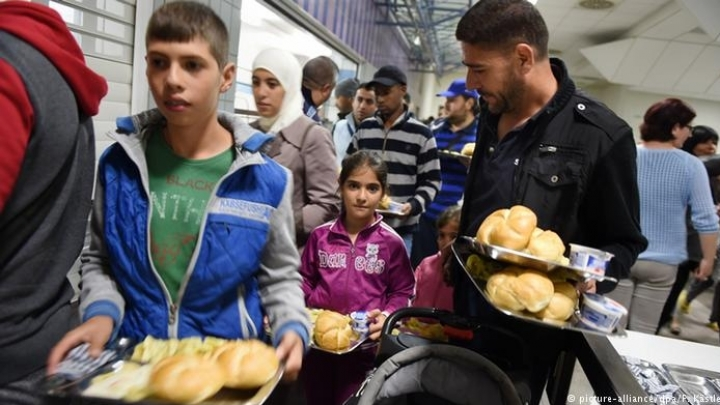 Merkel urges big company bosses to help hire refugees. What's key hindrance?