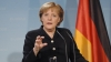 Merkel regrets her open-door policy concerning migrants; braces for fourth term