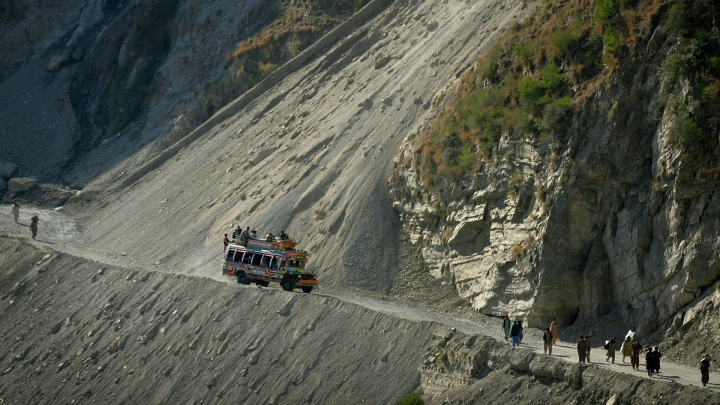 24 dead after minibus plunges off cliff into river in a remote are of Kashmir