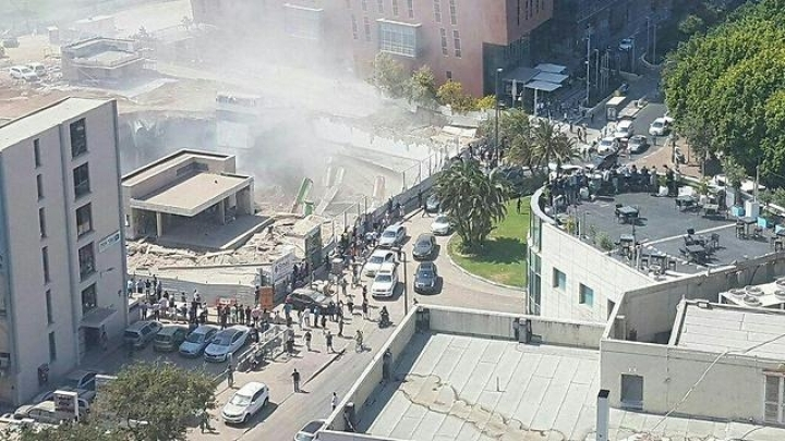 Many injured and at least 15 trapped in Tel Aviv building collapse