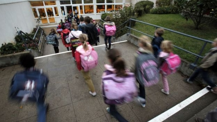 French children return to school amid high security