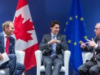 EU and Canada sign free trade agreement to be ratified by 40 national and regional legislatures in Europe
