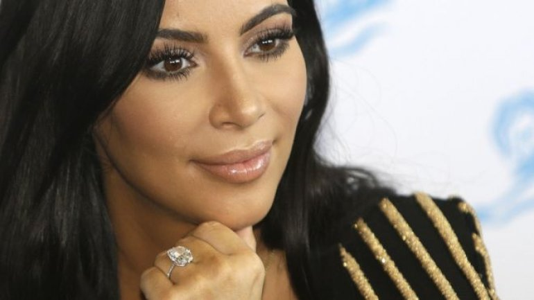 Kim Kardashian West sues gossip website over claims she faked robbery