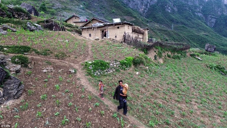 Chinese urbanization: Moving remote villagers to towns