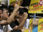 China could ban lawmakers from Hong Kong parliament as crisis escalates