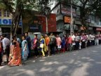 India rupees: Chaos at banks continues after ATMs reopen