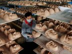 Japan factory swamped by demand for Trump masks
