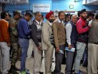 Cash for queues: people paid to stand in line amid India's bank note crisis