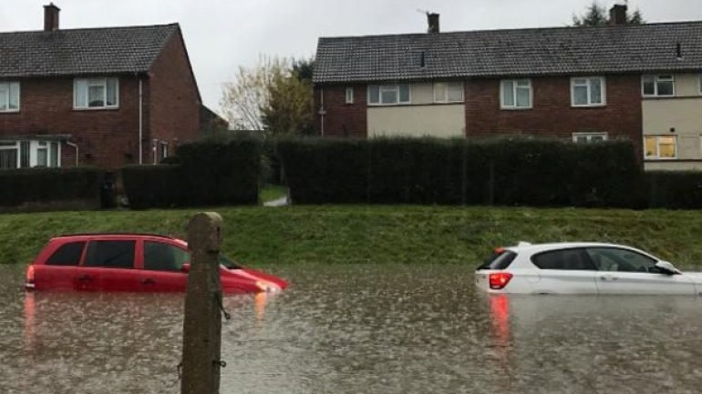 Storm Angus: floods hit south-west England – with more rain to come