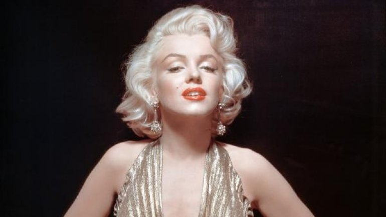 Auction houses rival in offering Marilyn Monroe memorabilia, including her grave marker