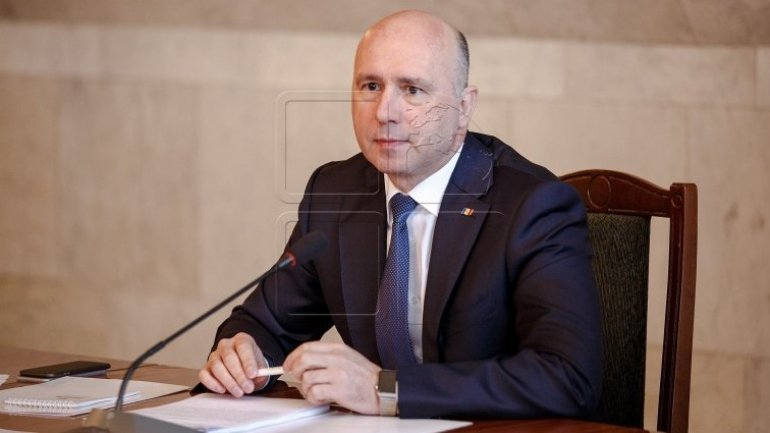 Prime minister Pavel Filip congratulates Romanian counterpart with National Day