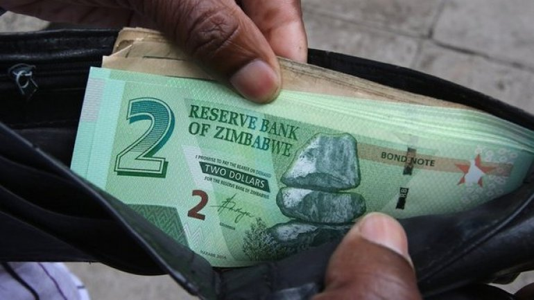 Mugabe launches new currency in 'last gamble' for Zimbabwe