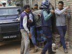 Woman blows herself up in Bangladesh raid on militant hide-out