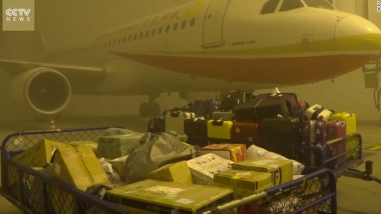 China: 20,000 people stranded at Chengdu airport over smog (VIDEO)