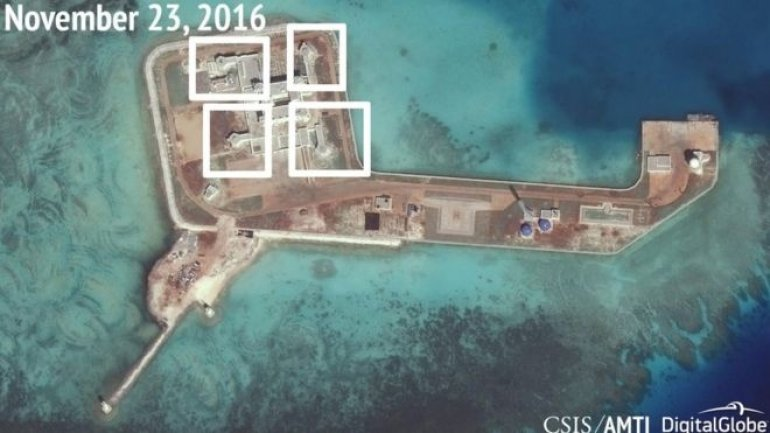 China builds weapons on controversial islands in South China Sea