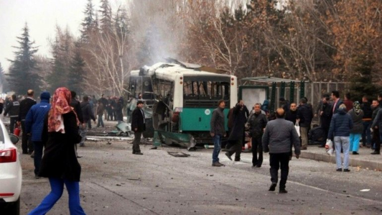 Turkish prime minister blames PKK for car blast that killed 13 soldiers on bus