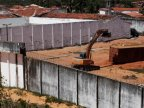 Brazilian authorities build temporary wall to stop deadly prison clashes