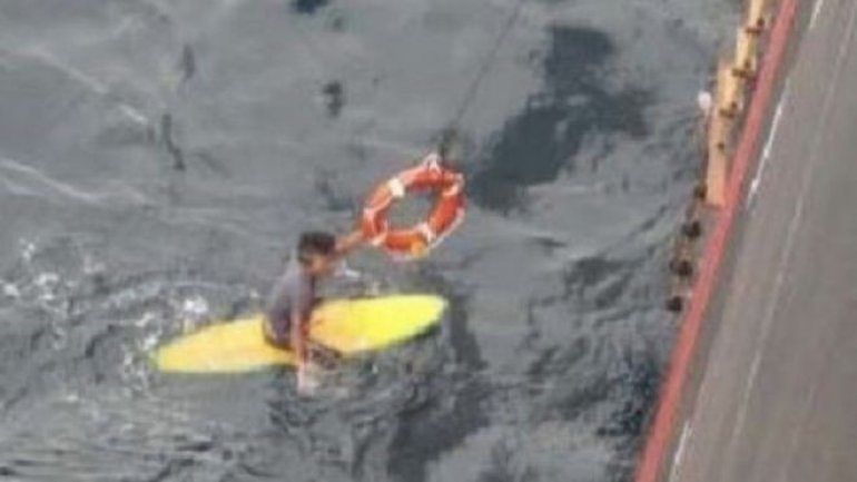 Japanese man rescued after night at sea on surfboard