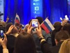 Crowd waves Russian flags in support of Donald Trump at rally