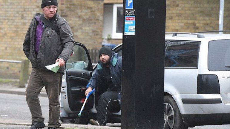 """""""Homeless"""" gang drives to Cambridge in Romanian car after BEGGING for cash"""
