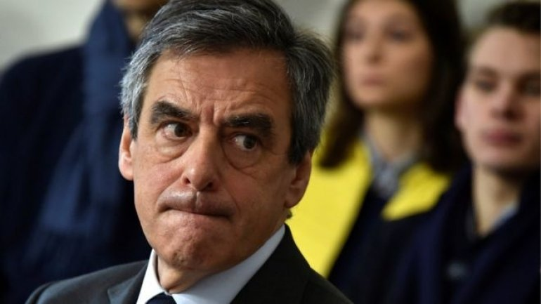 French presidential candidate Francois Fillon goes back on promise to quit if investigated