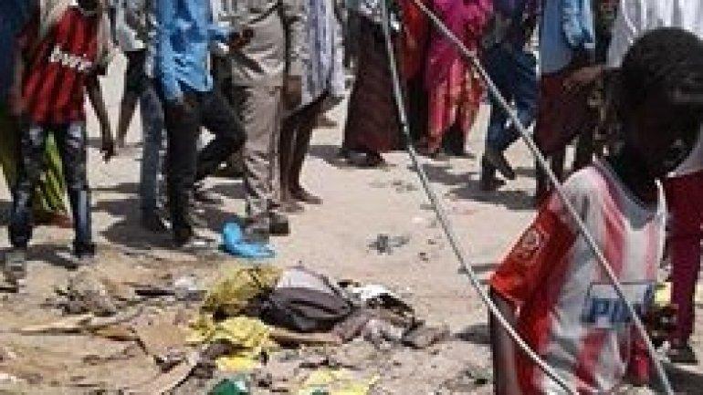 Car bomb explodes at market in Mogadishu, killing at least 30