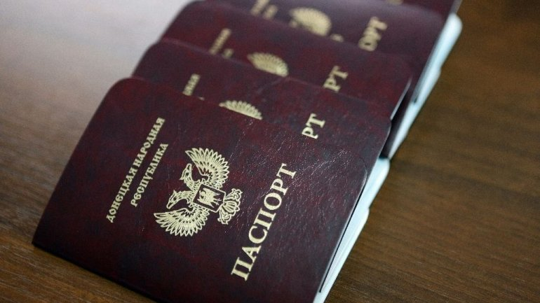 Russia's recognition of rebels' passports triggers Germany's criticism