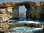 Azure Window rock formation near Malta FALLS into Mediterranean