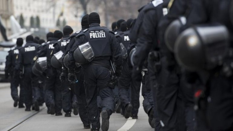German law-enforcers raid apartments and mosque visited by killer truck driver