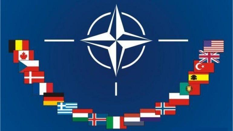 NATO puts big money in satellite, cyber defenses
