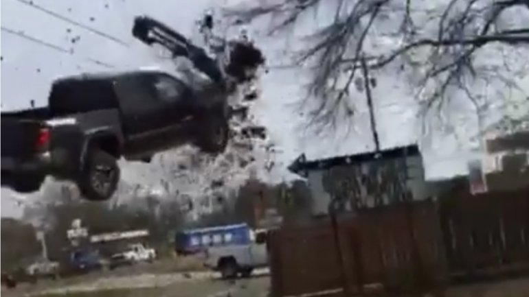 Truck chased by police launches into air, after hitting spike strip (VIDEO)