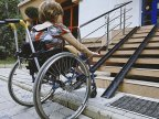 Disabled persons in difficulty to enter churches. Christians in wheelchair go through nightmare