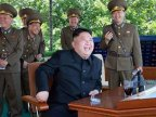 North Korean dictator GRINS as fighter jet DESTROYS enemy aircraft in war games