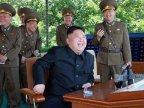 North Korean dictator GRINS as fighter jet DESTROYS enemy aircraft in war games