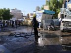 30 die as woman blasts explosive in Iraqi market