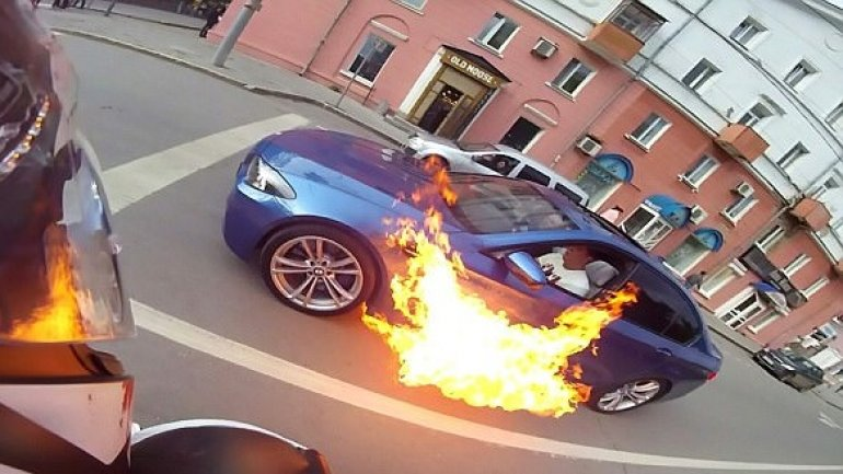 Russian man somehow escapes UNHURT after his BMW randomly burst into flames (VIDEO)