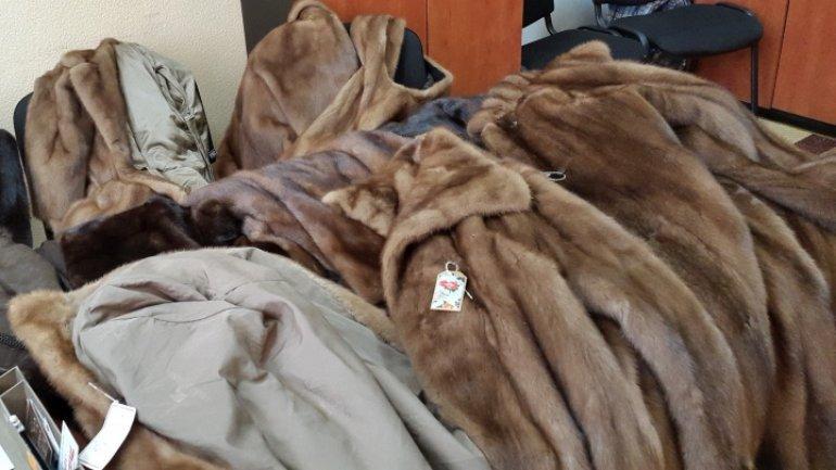 Fur vests hidden among parcels