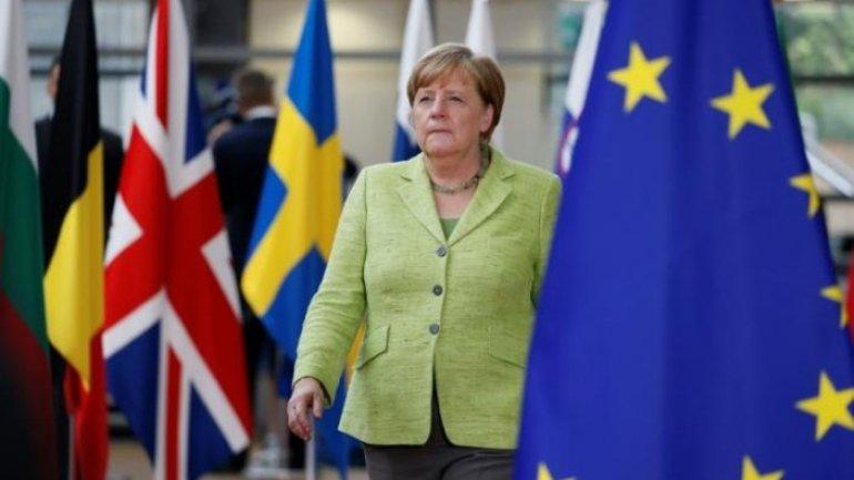 Merkel's conservatives widen lead three months before German vote