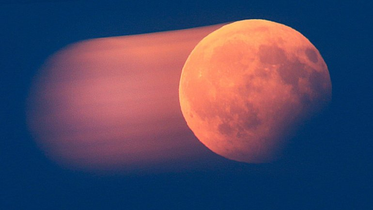 Stunning moon turns blood red during partial lunar eclipse across Europe