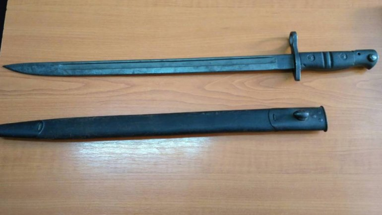 Nine coins and a bayonet found in packages with different declared content