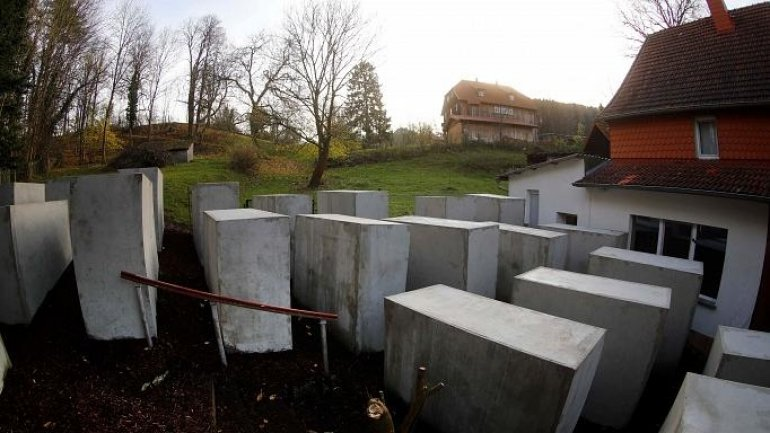 Activists mock German far-right politician, by building Holocaust memorial replica outside his home