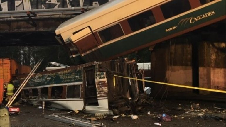 Train carriages plunged on US motorway after crash in Washington
