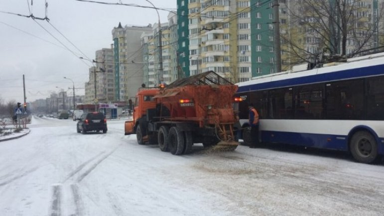 Winter streets troubling Chisinau traffic. Exdrupo specialized vehicles operating non-stop